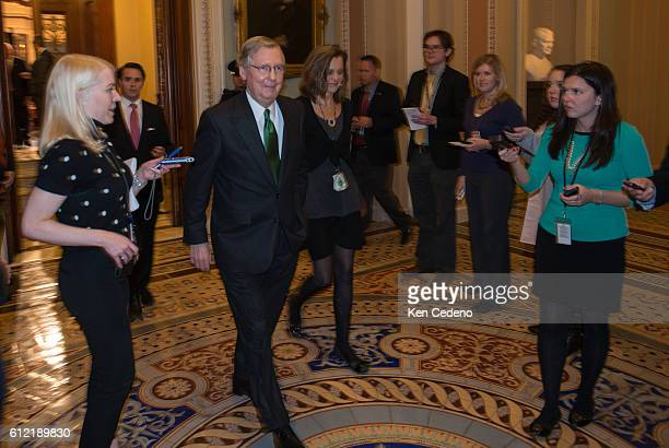 Minority Leader Senator Mitch McConnell walks from the Senate floor to his office working in a possible deal to prevent the 'fiscal cliff' on Capitol...