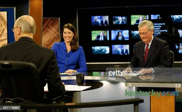 Minority Leader US Sen Mitch McConnell and Kentucky Secretary of State Alison Lundergan Grimes prepare with host Bill Goodman before their debate on...