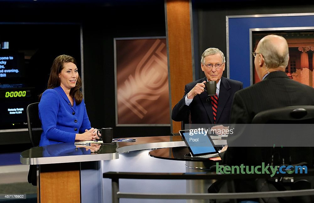 Minority Leader U.S. Sen. Mitch McConnell (R) and Kentucky Secretary of State <a gi-track='captionPersonalityLinkClicked' href=/galleries/search?phrase=Alison+Lundergan+Grimes&family=editorial&specificpeople=10892500 ng-click='$event.stopPropagation()'>Alison Lundergan Grimes</a> (D) prepare with host Bill Goodman before their debate on 'Kentucky Tonight' at the KET Network Center on October 13, 2014 in Lexington, Kentucky. Voters go to the polls on November 4, 2014.