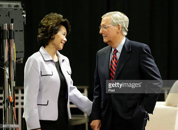 Minority Leader US Sen Mitch McConnell waits with wife Elaine Chao before his debate against challenger Kentucky Secretary of State Alison Lundergan...