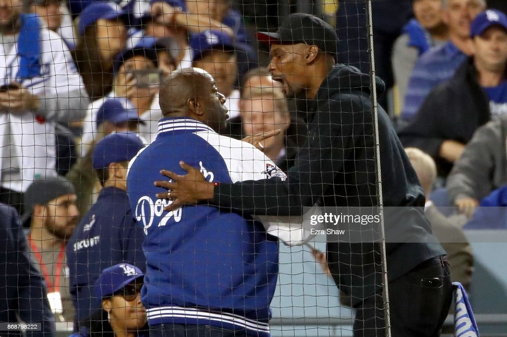 Minority Los Angeles Dodgers owner Earvin 'Magic' Johnson Jr. (L) greets NBA player Chris Bosh during game six of the 2017 World Series between the Houston Astros and the Los Angeles Dodgers at Dodger Stadium on October 31, 2017 in Los Angeles, California.