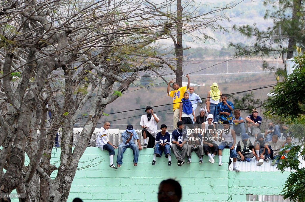Minors seat on the roof of the premises after a fight between members of Los Chirizos and Mara 18 gangs in the Renacimiento juvenile correctional...