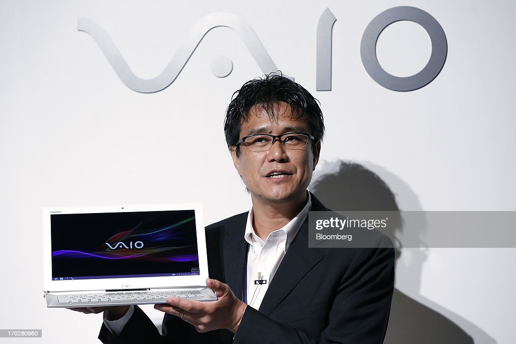 Minoru Shimizu, senior manager at Sony Corp., holds the company's Vaio Duo Ultrabook laptop computer during a product launch in Tokyo, Japan, on Monday, June 10, 2013. Sony Corp. is Japan's biggest consumer-electronics exporter. Photographer: Kiyoshi Ota/Bloomberg via Getty Images