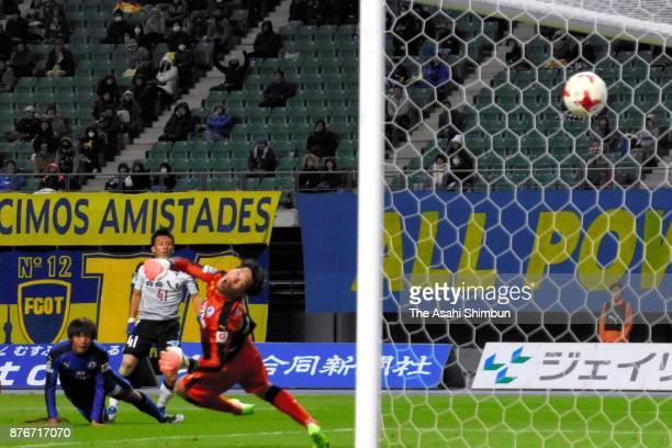 Minoru Suganuma of Roasso Kumamoto scores the opening goal during the JLeague J2 match between Oita Trinita and Roasso Kumamoto at Oita bank Dome on...