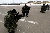 United States Navy Sea, Air and Land Forces help to train a total of 200 Minot AFB security forces members on recapturing and combat tactics.