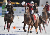 MINPolo players challenge during a game on January 23 2011 in KlostersThe little village of Klosters in the Swiss alps that is betterknown as the...