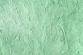 Trendy mint colored rouge concrete textured background for concept or product. Toned image.
