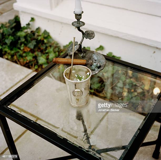A mint julep and cigar are photographed for Town Country Magazine on May 6 2012 in Louisville Kentucky PUBLISHED IMAGE