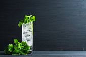 Mint julep in glass on the wooden background