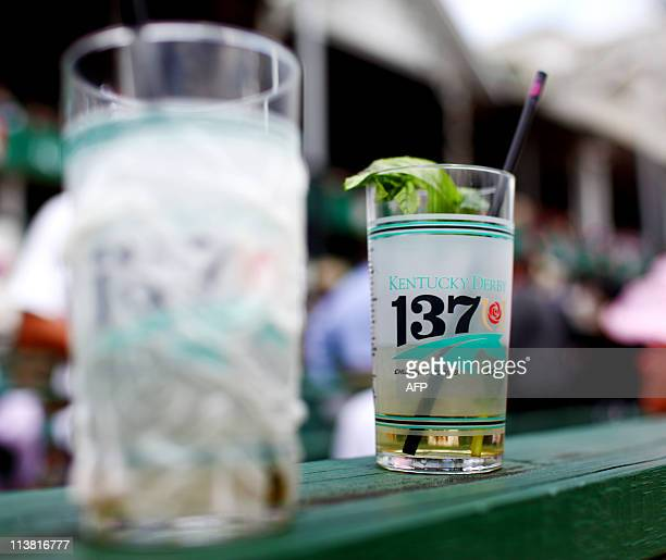 A Mint Julep the official drink of the Kentucky Derby is seen in the grandstand on Kentucky Oaks Day on the eve of the 137th Running of the Kentucky...