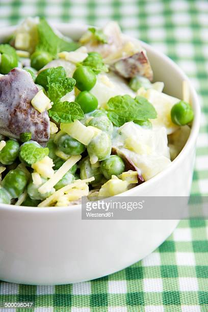 Minted pea and potato salad in bowl
