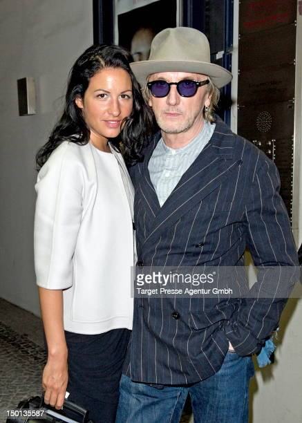 Minu Barati and Marius MuellerWesternhagen attend the opening of the exhibition 'Beyond Faces' at Camera Work on August 10 2012 in Berlin Germany