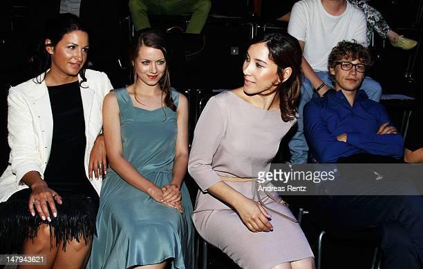Minu BaratiFischer Alice Dwyer Sibel Kekilli and Tim Bendzko sit in a front row prior to the Kilian Kerner Show at MercedesBenz Fashion Week...