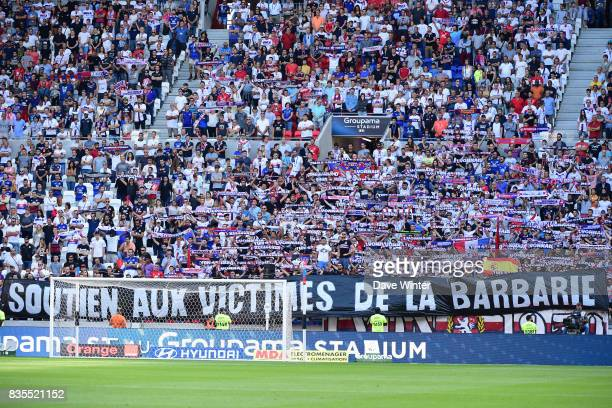 A minute of silence for the victims of the attacks in Barcelona is held before the Ligue 1 match between Olympique Lyonnais and FC Girondins de...
