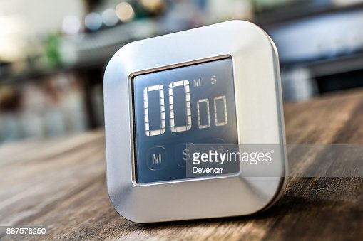 0 Minutes - Digital Chrome Kitchen Timer On Wooden Table : Stock Photo