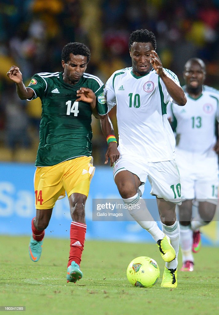 AFRICA - JANUARY 29, Minyahile Teshome of Ethiopia and John Obi Mikel of Nigeria during the 2013 African Cup of Nations match between Ethiopia and Nigeria at Royal Bafokeng Stadium on January 29, 2013 in Rustenburg, South Africa.