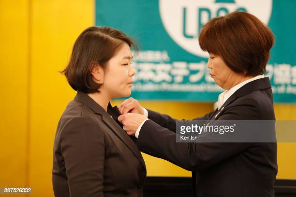 MinYoung Lee of South Korea from LPGA president Hiromi Kobayashi during the Ladies Professional Golfers' Association of Japan induction ceremony at...