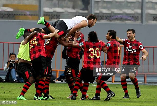 Minzum Quina of FBC Melgar celebrates with his teammates the second goal of his team against Sporting Cristal during a first leg final match between...