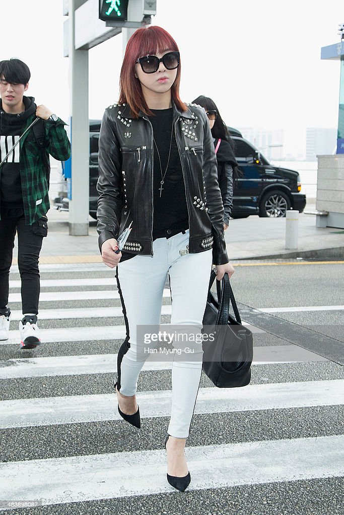 Minzy of South Korean girl group 2NE1 is seen on departure at Incheon International Airport on April 10, 2014 in Incheon, South Korea.
