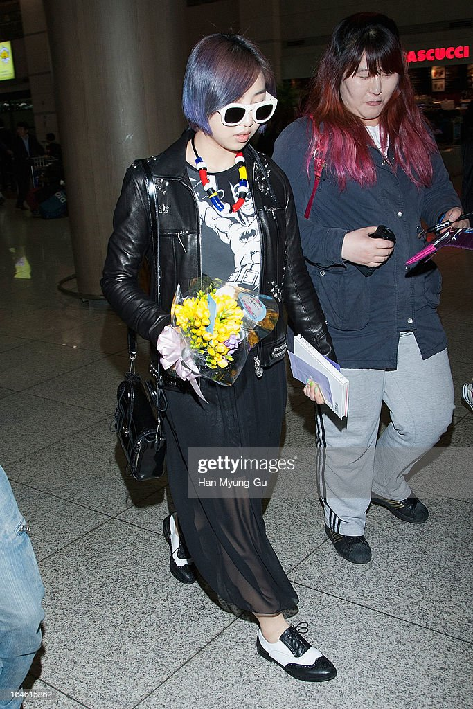 Minzy of South Korean girl group 2NE1 is seen upon arrival at Incheon International Airport on March 25, 2013 in Incheon, South Korea.