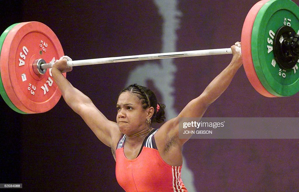 Miosotis Heredia of the Dominican Republic lifts during the Snatch portion of the Women's 69kg Weightlifting competition 06 August 1999 at the Pan Am Games in Winnipeg, Canada. Heredia won the silver medal with a combined lift of 205kg.