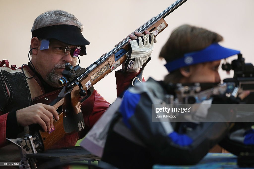 Miquel Orobitg Guitart of Spain (L) and Natascha Hiltrop of Germany (R) compete in the mixed R6-50m Rifle Prone- SH1 qualification round on day 6 of the London 2012 Paralympic Games at The Royal Artillery Barracks on September 4, 2012 in London, England.