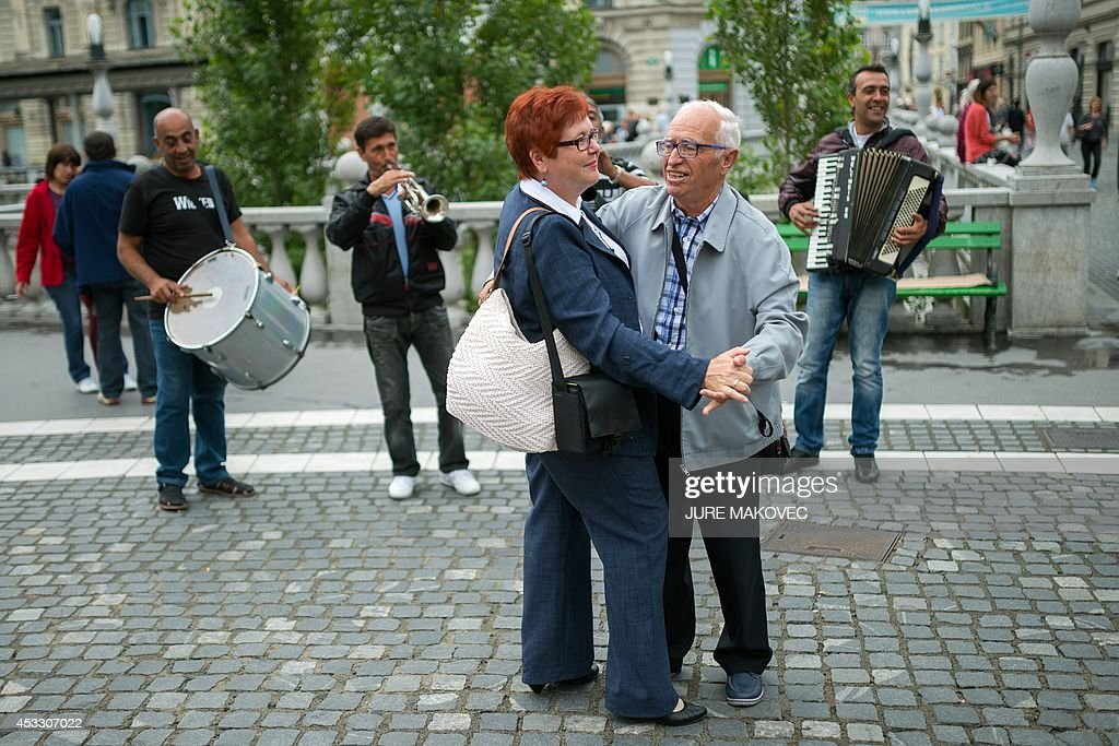 Miquel Ribas, an 82-year old Spaniard, dances with Diana Janezic, who in charge of entertainment projects at the Topolsica care home, as he visits Ljubljana on July 28, 2014, during a week-long trip to Slovenia. Ribas, who lives in a care home in Mataro, on the Spanish coast near Barcelona, has free accommodation during his trip in a similar care home in Topolsica, Slovenia, provided by Jozica Kucera, a 77-year-old Slovenian widow, who will spend the same time in his room in Spain. This is the first international exchange of rooms in care homes for seniors, organized by social networking agency Linkedage, a Slovenian company that developed a web platform to link residences all over Europe and the world to enable similar exchanges or to rent vacant rooms.