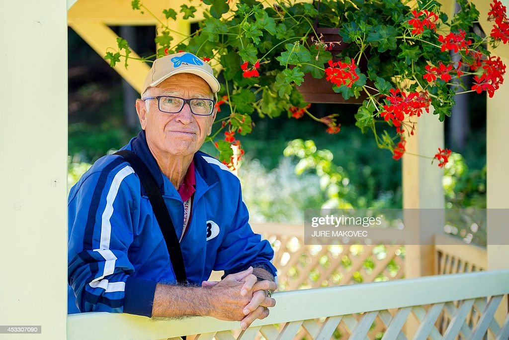 Miquel Ribas, an 82-year old Spaniard, poses at a care home for the elderly in Topolsica on July 24, 2014, during a week-long trip to Slovenia. Ribas, who lives in a care home in Mataro, on the Spanish coast near Barcelona, has free accommodation during his trip in a similar care home in Slovenia, provided by Jozica Kucera, a 77-year-old Slovenian widow, who will spend the same time in his room in Spain. This is the first international exchange of rooms in care homes for seniors, organized by social networking agency Linkedage, a Slovenian company that developed a web platform to link residences all over Europe and the world to enable similar exchanges or to rent vacant rooms.