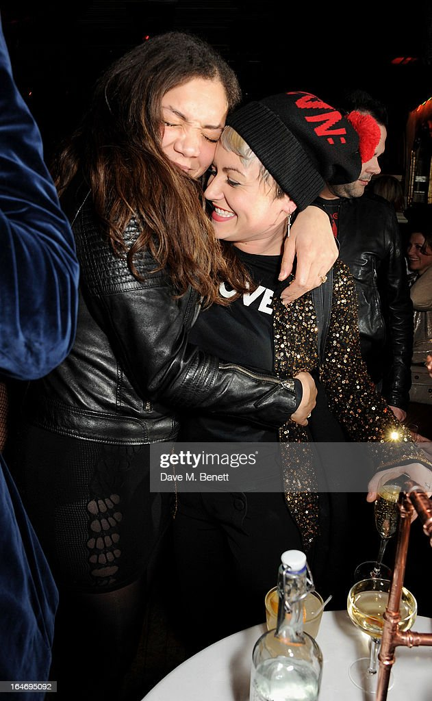 Miquita Oliver (L) and Jaime Winstone attend the ABSOLUT Elyx launch party at The Box Soho on March 26, 2013 in London, England.