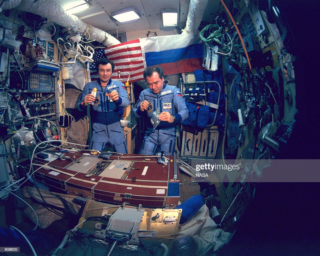 Mir 18 crew Vladimir Dezhurov left and Gennady Strekalov enjoy a meal inside the Mir space station On March 12 it has been reported that the aging...