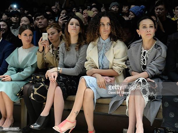 Mira Duma guest Beren Saat Kangana Ranaut and Carina Lau sits front row at Burberry Womenswear Autumn/Winter 2014 at Kensington Gardens on February...