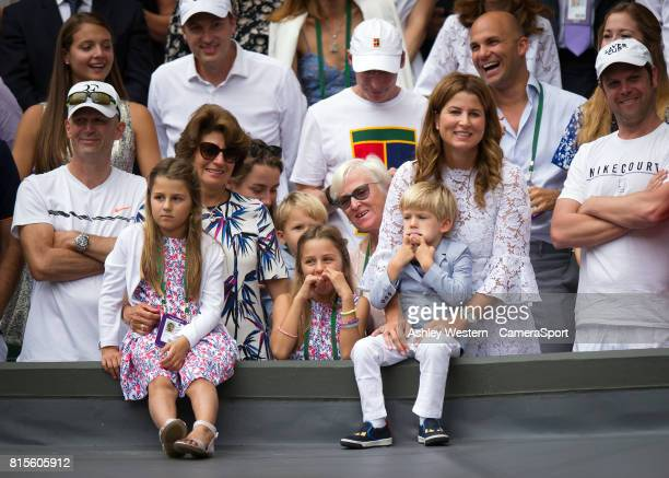 Mira Federer and family look on as Roger is interviewed by Sue Barker after his victory over Marin Cilic at Wimbledon on July 16 2017 in London...
