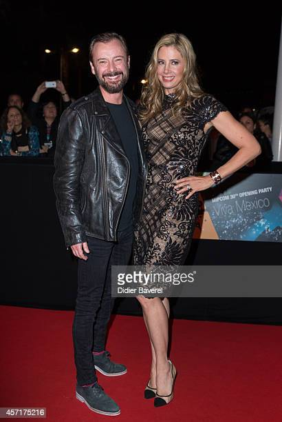 Mira Sorvino and John Simm attend the opening red carpet party MIPCOM 2014 at Hotel Martinez on October 13 2014 in Cannes France