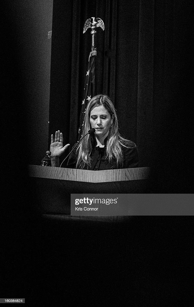 <a gi-track='captionPersonalityLinkClicked' href=/galleries/search?phrase=Mira+Sorvino&family=editorial&specificpeople=203143 ng-click='$event.stopPropagation()'>Mira Sorvino</a> speaks during Georgetown University's Institute for the Study of International Migration forum on January 30, 2013 in Washington, DC.