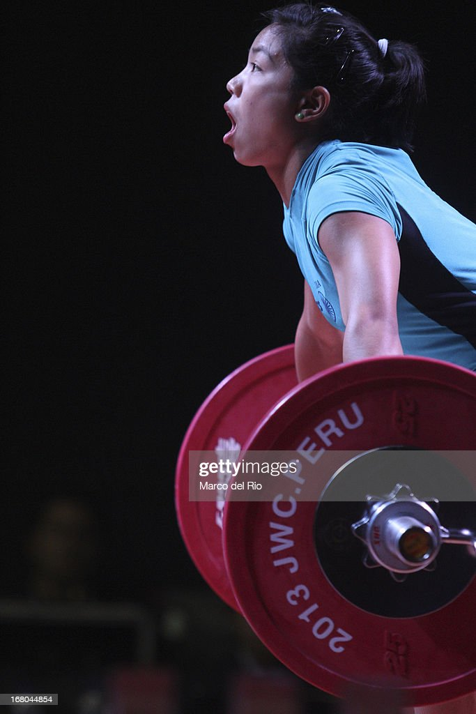 Mirabai Chanu Saikhom of India A competes in the Women's 48kg snatch during day one of the 2013 Junior Weightlifting World Championship at Maria Angola Convention Center on April 04, 2013 in Lima, Peru.