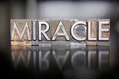 The word MIRACLE written in vintage lead letterpress type
