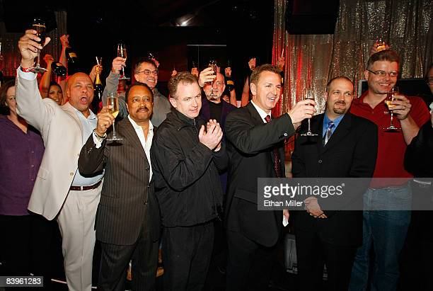Mirage Hotel Casino President and Chief Executive Officer Scott Sibella and shares a champagne toast with VIP guests at The Beatles Revolution Lounge...