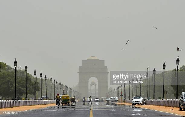 A mirage shimmers over Rajpath leading to India Gate in New Delhi on May 28 2015 More than 1100 people have died in a blistering heatwave sweeping...