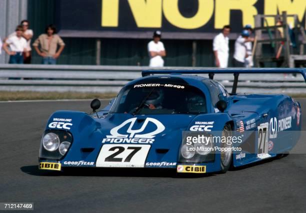 A MirageCosworth M12 driven by Mario and Michael Andretti of the United States for Grand Touring Cars Inc in a practice session prior to the start of...