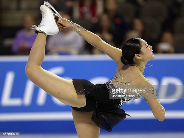 Mirai Nagasu competes in the Ladies Free Skating during the 2014 Hilton HHonors Skate America competition at the Sears Centre Arena on October 26...