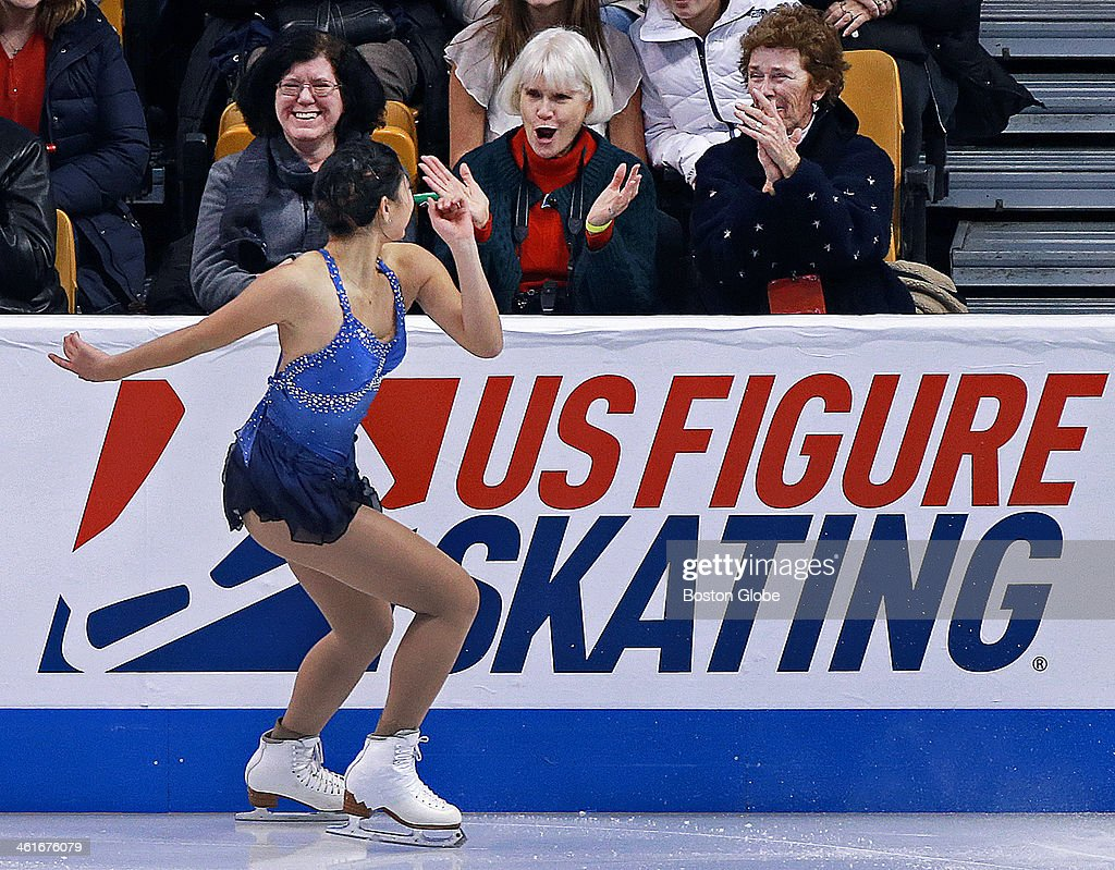 Mirai Nagasu gets a reaction from some front row fans as she competes during the Championship Ladies Short Program at the US Figure Skating Championships being held at the TD Garden.