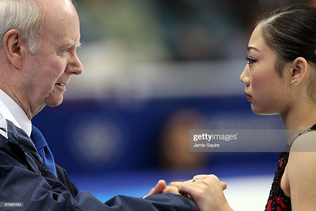 Mirai Nagasu of the United States reacts in the kiss and cry area with coach Frank Carroll in the Ladies Free Skating on day 14 of the 2010 Vancouver Winter Olympics at Pacific Coliseum on February 25, 2010 in Vancouver, Canada.