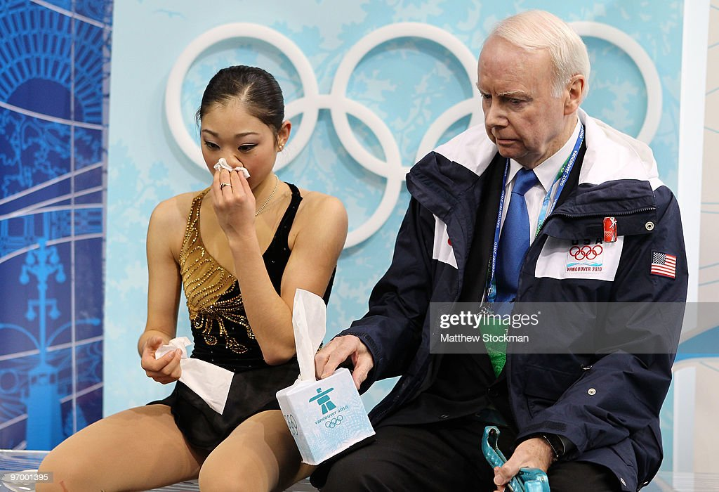<a gi-track='captionPersonalityLinkClicked' href=/galleries/search?phrase=Mirai+Nagasu&family=editorial&specificpeople=4125421 ng-click='$event.stopPropagation()'>Mirai Nagasu</a> of the United States wipes blood from her nose in the kiss and cry area in the Ladies Short Program Figure Skating on day 12 of the 2010 Vancouver Winter Olympics at Pacific Coliseum on February 23, 2010 in Vancouver, Canada.