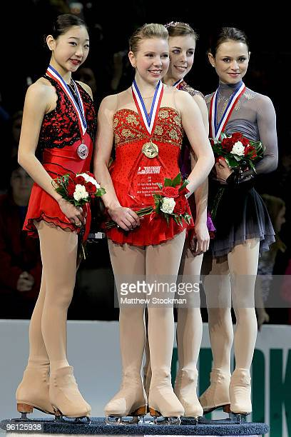 Mirai Nagasu Rachael Flatt Ashley Wagner and Sasha Cohen pose for photographers after the medal ceremony for the championship ladies event during the...