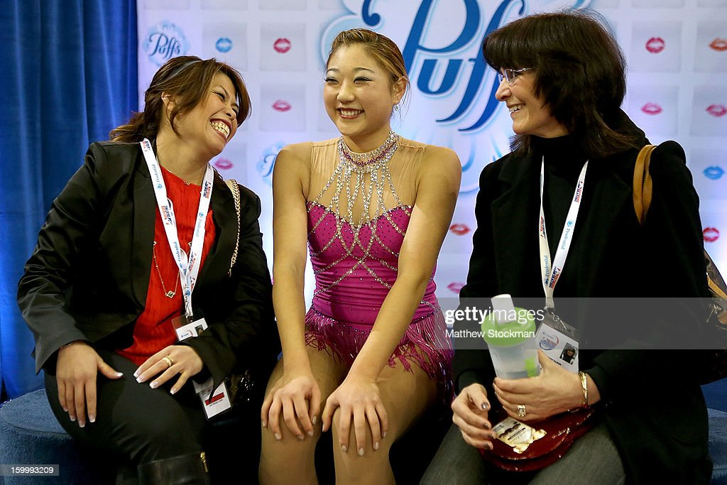 Mirai Nagasu watches her score in the kiss and cry with coaches Amy Evidente and Wendy Olson after skating in the Ladies Short Program during the 2013 Prudential U.S. Figure Skating Championships at CenturyLink Center on January 24, 2013 in Omaha, Nebraska.