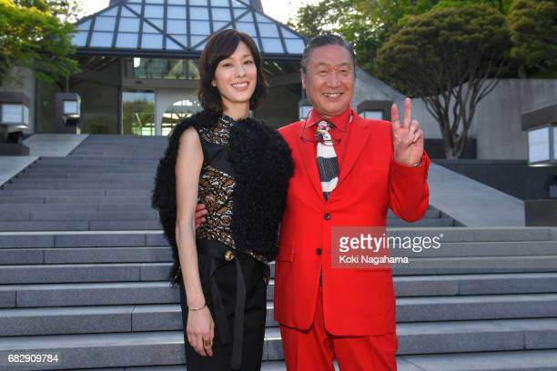 Mirai Yamamoto and Kansai Yamamoto pose for photographs during the Louis Vuitton Resort 2018 show at the Miho Museum on May 14 2017 in Koka Japan