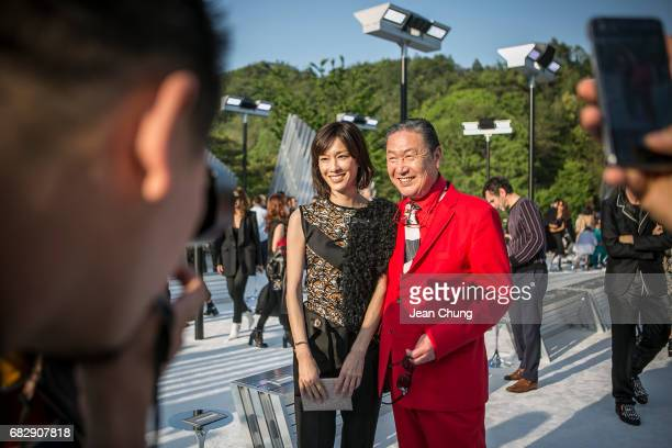 Mirai Yamamoto center left and Kansai Yamamoto center right attend the Louis Vuitton Resort 2018 show at the Miho Museum on May 14 2017 in Koka Japan