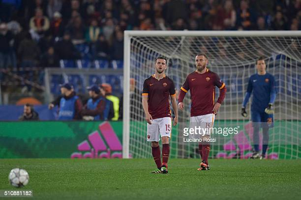 Miralem Pjanic and Daniele De Rossi of AS Roma disappointed after goal scored by Cristiano Ronaldo during the UEFA Champions League Round of 16 First...