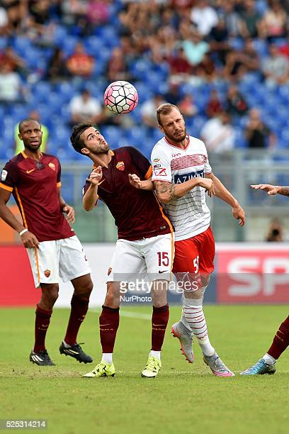 Miralem Pjanic and Matteo Fedele fight for the ball during the Italian Serie A match between AS Roma and FC Carpi at Stadio Olimpico in Rome on...