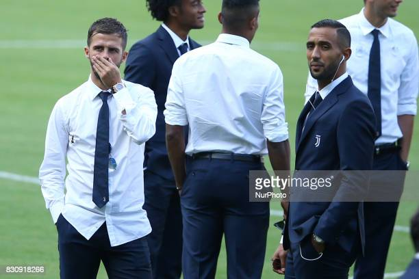 Miralem Pjanic and Mehdi Benatia of Juventus during the Juventus Walk Around ahead of the Italian Supercup at Olimpico Stadium on August 12 2017 in...